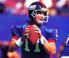 Quarterback, New York Giants Age: 32 (Nov. season in pro football & with Giants College: Morehead State Height: Weight:. Football Cards, Football Players, Football Helmets, Phil Simms, New York Giants Football, G Man, Sports Figures, Nfl Sports, Athletes