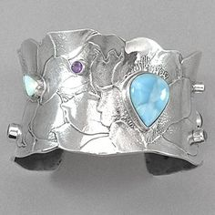 """Tabra Larimar Sterling Silver Floral Cuff Bracelet.  Sterling silver cuff style bracelet embossed with a floral pattern and set with opal, garnet, blue topaz, amethyst, and smoky quartz. Measures 1 3/8""""W x 6 1/4"""" L"""