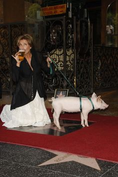 Emma Thompson.  And a pig on a leash.  And an extended pinkie. And beer.