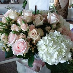 Soft and feminine bouquet featuring Quicksand and Sweet Avalanche Roses