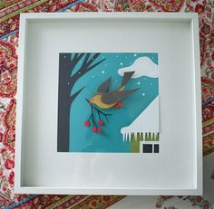 paper crafted winter scene in shadow box