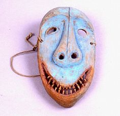 OBJECT #	   	1.2E1051  OBJECT NAME	   	Mask  CULTURE OF ORIGIN	   	Yup'ik  MATERIALS	   	Driftwood, Carved, Paint, Blue, Red, Wire  DIMENSIONS	   	L: 23.5 cm, W: 12.0 cm  SOURCE	   	Museum of History and Industry  CREDIT	   	Gift of Museum of History and Industry