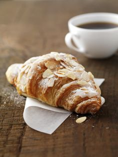 Almond Croissant | Holidays don't come every day but you can still indulge in a heavenly escape with this buttery croissant filled with sweet almond paste. Topped with toasted flaked almonds and a dusting of icing sugar, it's absolutely delicious.