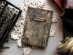 Aged mixed media diary by Maria Lillepruun
