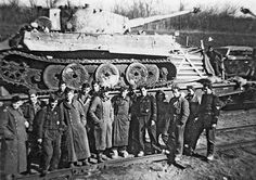 A very worn and in need of refurbishment, this Tiger 1 is loaded on a military train ready to be taken to a repair facility while the crew and others catch up with each other. Railway Gun, Tiger Tank, Tiger Tiger, Ww2 Photos, Ww2 Tanks, Panzer, War Machine, Military History, World War Ii