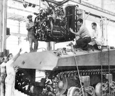 """""""Lowering the Chrysler multibank engine into a Sherman tank."""" """"Lowering the Chrysler multibank engine into a Sherman tank. Bugatti, Heroes And Generals, Patton Tank, Us Armor, Ww2 History, Military History, Tank Armor, Sherman Tank, Train Truck"""