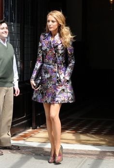 'The Age Of Adaline' actress Blake Lively steps out of a downtown New York City, New York hotel wearing a shiny flowered trench coat on May ...