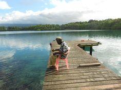 Morning ritual feeding fish - Kalabungara Sol Isles