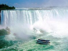 Niagra Falls - Canada: On the Maid of the Mist, I sailed on this little boat right inbetween both the Canadian and United States/New York sides of the falls.  It felt like I was standing in the middle of a rain-storm!  SO AWESOME!!!!
