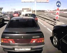 Russian Driver Acknowledges Successful Merge By Pointing a Gun Out The Window http://www.omglmaowtf.com/russian-driver-points-gun-out-window