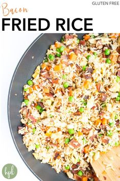 This Bacon Fried Rice is a gluten free comfort food, made slightly healthy with the addition of veggies. It's an easy recipe for family dinners, or put an egg on top and eat it for breakfast. Plus you can use up some freezer and pantry staples like frozen veggies and rice. A fun, kid friendly meal!