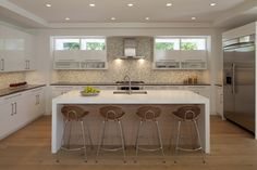 """3"""" thick Corian Cirrus White. Eased edge. 3'-6""""x8'-6"""".  painted MDF cabinets. The finish is super gloss. 5"""" cans from Juno."""