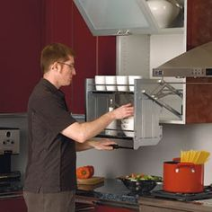 Series Premiere Pull Down Shelving Systems By Rev-A-Shelf - finally shelves for short people. Hanging Kitchen Cabinets, Kitchen Cabinet Organization, Kitchen Shelves, Kitchen Storage, Cabinet Organizers, Shelf System, Shelving Systems, Pull Down Shelf, Rev A Shelf
