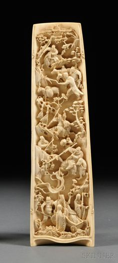 Ivory Wrist Rest, China, 19th century, top side carved in low relief of villages outside a mountainous landscape, underside deeply carved with men on horseback during a battle scene, wd. 2 3/4, lg. 9 7/8 in.