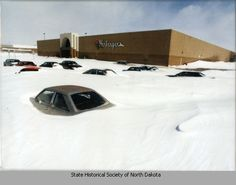 Cars covered in snow, Kirkwood Mall parking lot, Bismarck, N.D 1997