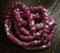 prop intestines- for my gross out boxes.   Ingredients: bubble wrap, paper towels soaked in beet juice, plastic food wrap, scotch tape, and white thread. Yum!