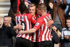 Ward-Prowse is congratulated by team-mates Steven Davis and Sadio Mane after his goal gave...