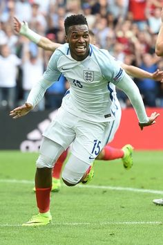 England's forward Daniel Sturridge celebrates scoring the 2-1 goal during the Euro 2016 group B football match between England and Wales at the Bollaert-Delelis stadium in Lens on June 16, 2016..England won the match 2-1. / AFP / PAUL ELLIS