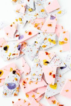 This pretty pastel chocolate bark is topped with edible flowers. We're packing it for our next picnic!