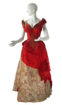 Worth evening dress, 1887-88, scarlet brocade, cream lace, and feathers