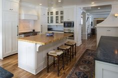 Saratoga Soapstone in Hudson Ash and Heritage Wood countertops in Maple Butcher Block.