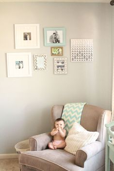 grey nursery glider with gallery wall