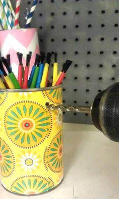 Recycle cans into pegboard organizers for the garage or craft room, even the kitchen.