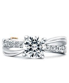 For not liking rings that aren't symmetrical, i really like this. surge  Engagement Ring - Mark Schneider Design