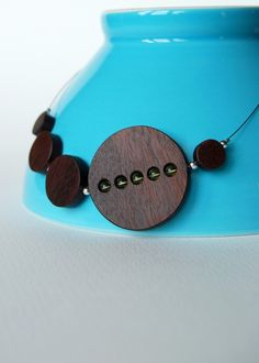 Love unique wooden jewelry.