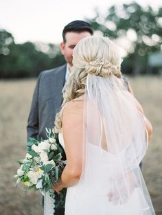 20 Ways to Wear a Veil With Your Wedding Hairstyle - Whether you're sporting a formal updo or long, loose waves, here's the lowdown on wedding hairstyles with veils. half-up hairstyle with a veil {Charla Storey Photography}