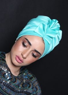 ready-to-wear Elegant fan-top turban in turquiose Silky Satin. Great for evening-wear or special events. The turban is stretchy, light, and easy to wear! No tying involved, this turban is worn like a hat. Can be worn as a full or half head covering-