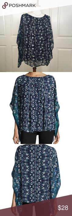 MAX STUDIO Georgette Poncho Top New with tags pullover Georgette poncho top with pleated round neckline and 3/4 cape sleeves. Asymmetric hem with pretty floral geometric design in blue. Polyester. Dry Clean recommended. Size Small. Max Studio Tops