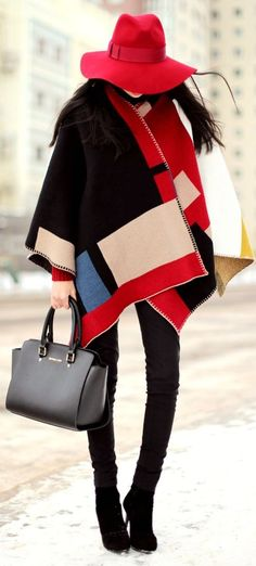 Black/ red/ blue poncho/ scarf with black skinny jeans, boots and a red fedora