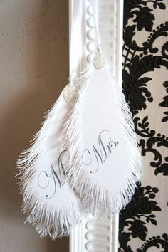 Mr & Mrs Wedding Signs FEATHER's in white. €21.00, via Etsy.