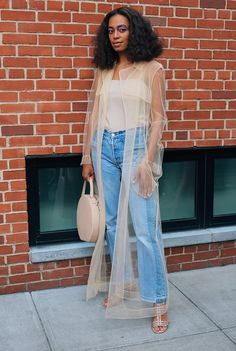 Solange Knowles Maryam Nassir Zadeh jeans and shoes with a Mansur Gavriel bag. On the street at New York Fashion Week. Photographed by Phil Oh.