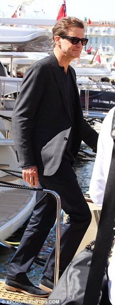 Colin Firth and wife Livia Giuggioli leave their elegant Cannes yacht Stylish Sunglasses, Mens Sunglasses, Fashion Documentaries, Elegant Couple, Colin Firth, Pride And Prejudice, Cannes Film Festival, Dapper, Handsome