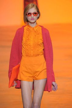 I am all about this look! Cute sunglasses and lots of bold orange!