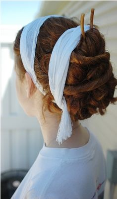 """""""This hairstyle is made using strips of cloth, chopsticks and possibly braids. It is ancient Roman. It is a style used in Roman weddings."""""""