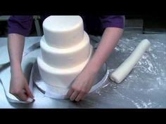 how to cover and layer a wedding cake! makes you kinda think twice about spending money on something that is soo easily  to do yourself :S    http://www.youtube.com/watch?v=URML0VxEo3I&feature=related