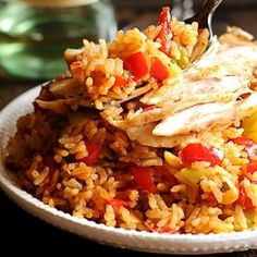 In this Instant Pot Cajun Chicken and Rice dish chicken and rice are perfectly seasoned with Cajun spices and Italian seasoning and pressure cooked in the instant pot together with chopped bell peppers scallions garlic and shallots. Gluten free and dai Cajun Chicken And Rice, Italian Chicken Pasta, Chicken And Rice Dishes, Creamy Chicken Pasta, Shrimp Pasta, Garlic Shrimp, Pesto Shrimp, Cajun Shrimp, Pasta Recipes