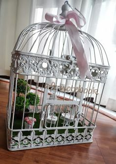 Miniature garden in a birdcage