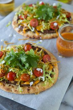 What a great idea to use naan bread as the base for a taco pizza! I'm also pleased to see that this recipe calls for refried black beans instead of regular ones. My hubby might actually eat these just because of that alone lol! I Love Food, Good Food, Yummy Food, Naan, Mexican Dishes, Mexican Food Recipes, Mexican Appetizers, Great Recipes, Favorite Recipes