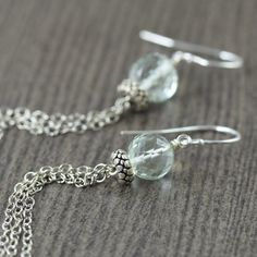 Green Amethyst gemstone earrings featuring long sterling silver chain dangles.