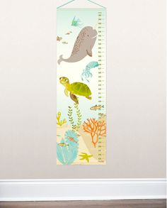 Youll have boatloads of fun measuring your little underwater explorer with our ocean growth chart.  A fine-tip permanent marker is a great way to note your childs age or an important date on the chart. Wipe up any spots or dust with a soft, damp cloth. Should the chart wrinkle, it can be ironed on the reverse/unprinted side on a low setting with light steam.  Printed in the USA on coated canvas Covered wooden dowels at top and bottom for stability Hanging is a breeze with an attached aqua…