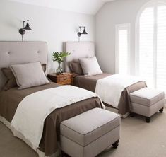 My upstairs guest room redo. Click through for more. Photo by Tori Aston. custom headboards, twin beds, ottomans, houndstooth