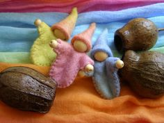 Gumnut Gnome Baby - a little gnome made with hand dyed pastel rainbow coloured felt tucked gently into an Australian gumnut.. $6.00, via Etsy.