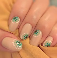 Green dotted nails