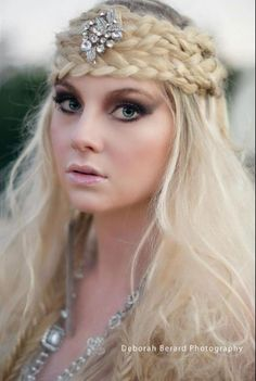 A whimsical bridal look is created using braids, curls and Aveda Texture Potion.