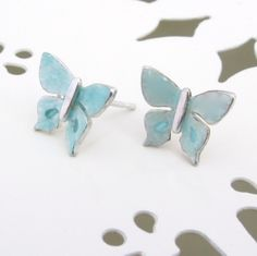 By Caroline Temple - Pale blue butterflies, delicate and pretty. Approx across the wings. Temple Jewellery, Blue Butterfly, Precious Metals, Butterflies, Wings, Bangles, Delicate, Stud Earrings, Jewels