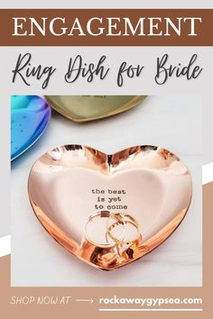 """Celebrate the bride or newly engaged couple with this heart shaped ring dish! The beautiful hand stamped quote ring holder reads, """"the best is yet to come,"""" and it's such a special custom engagement gift that the bride and groom will love to keep their rings in! Head to the website to personalize the dish, and choose your metal color and font type as well! #engagementgift #ringdish #engagementquote #giftforbride Heart Shaped Engagement Rings, Heart Shaped Rings, Engagement Quotes, Engagement Gifts, Cute Jewelry, Jewelry Gifts, Handmade Jewelry, Gifts For Your Sister, Handmade Gifts For Her"""